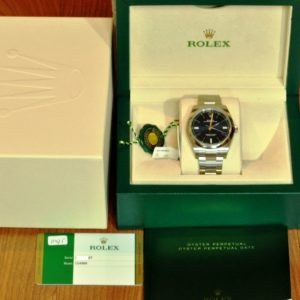 Rolex Oyster Perpetual 39mm ref 114300 Blue Index Never Worn