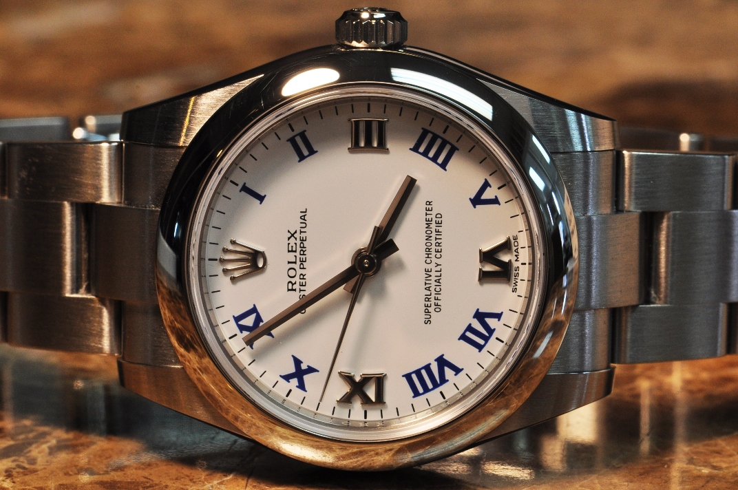 Rolex Oyster Perpetual 31 Mm White Dial With Blue Roman