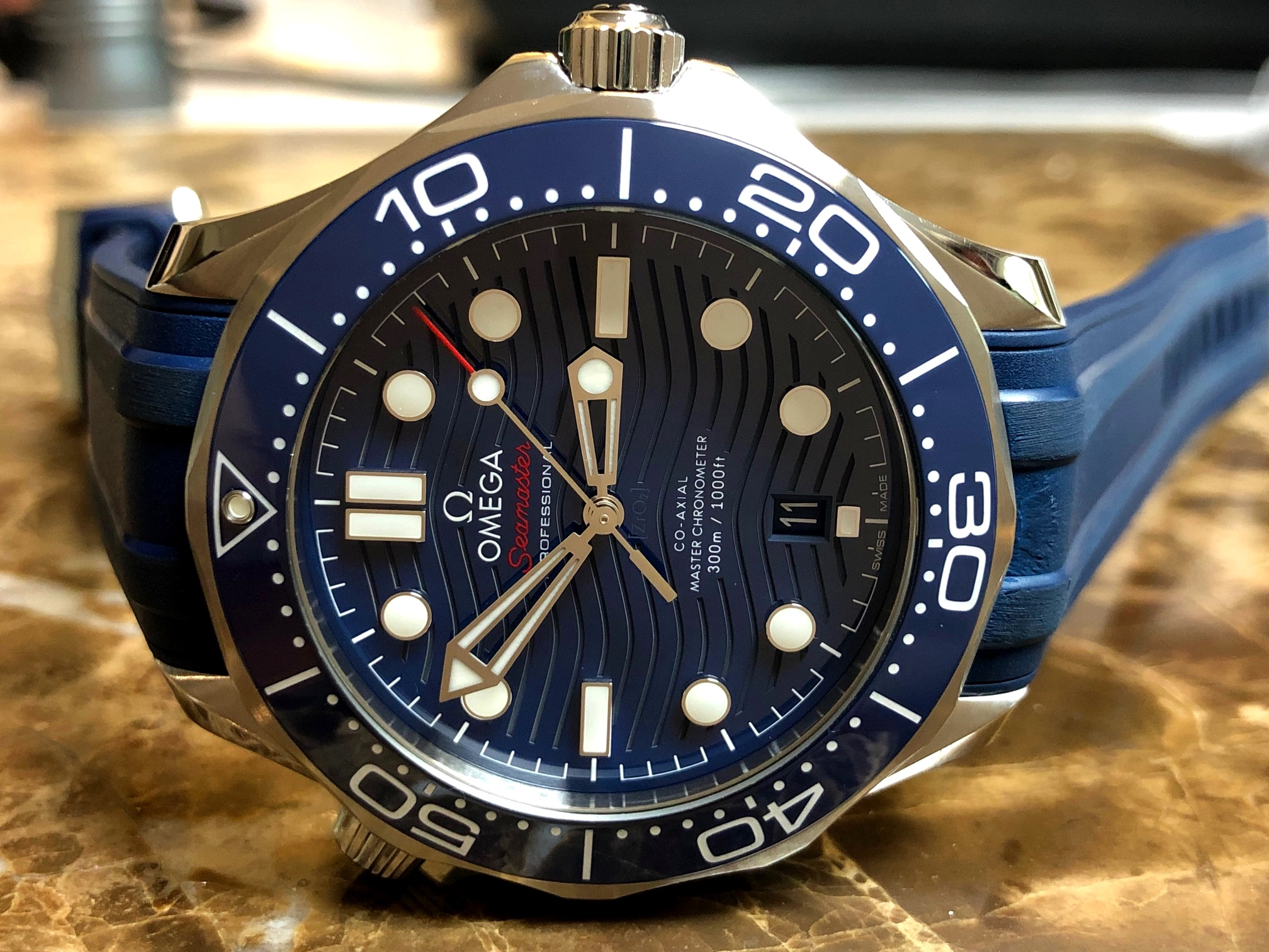 Omega seamaster diver 300m omega co axial master 42 mm blue wave rubber strap box papers 210 for Omega diver